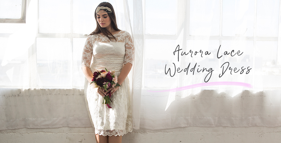 Model wears our Aurora Lace Wedding Dress