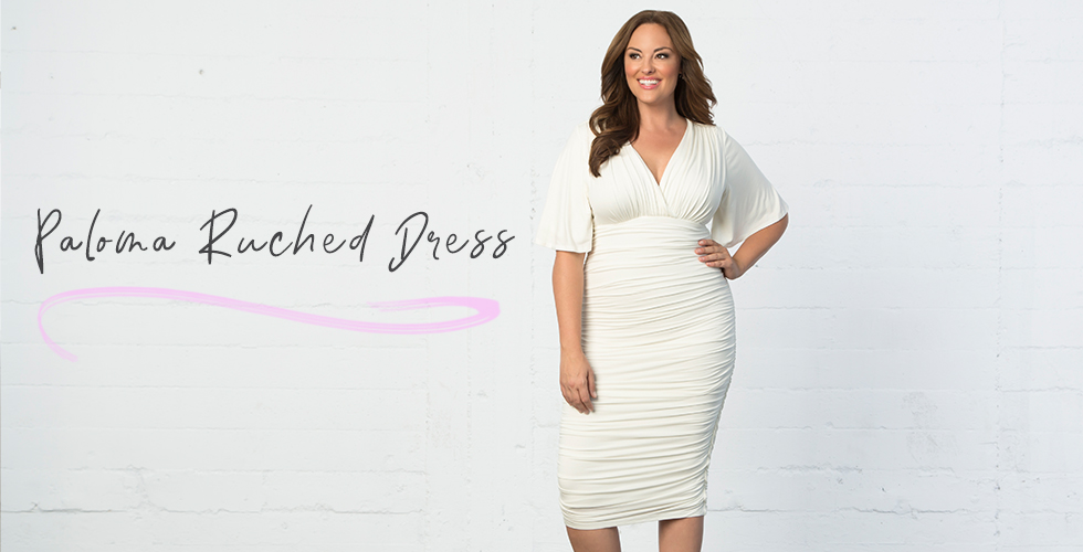 Our model wears our Paloma Ruched Dress.