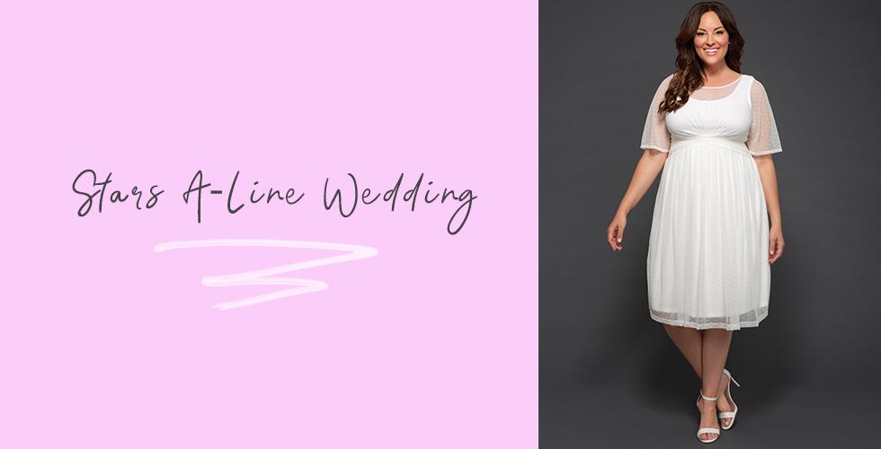 Model wears our Stars A-Line Wedding Dress.