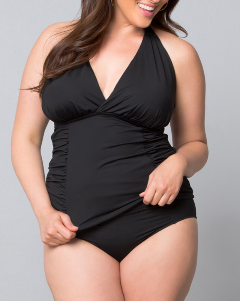 Women's plus size swim bottoms by Sorella Swim are an updated must-have! They've made their high rise swim bottoms two inches higher, to cover the belly button—creating a plus size vintage look swimsuit. This bottom also features shirred front and back center panels for a flattering fit with branded Sorella hardware on the back.